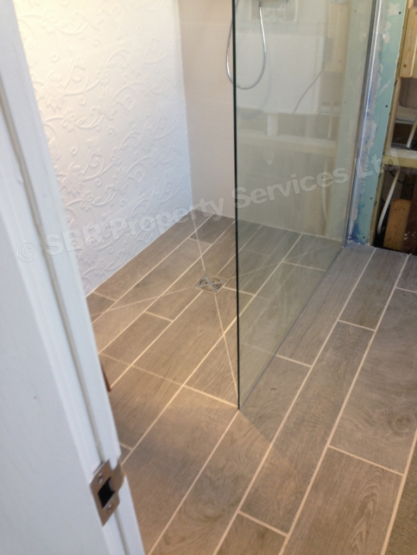 ... Wooden Plank Porcelain Tiles In Shower Room Under Construction ...